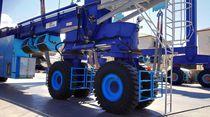Travel lift a ruote indipendenti / controllato a distanza / per carichi pesanti / quattro ruote motrici