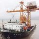 scaricatore di navi con benna / mobile