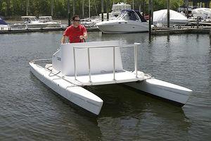 barca open catamarano