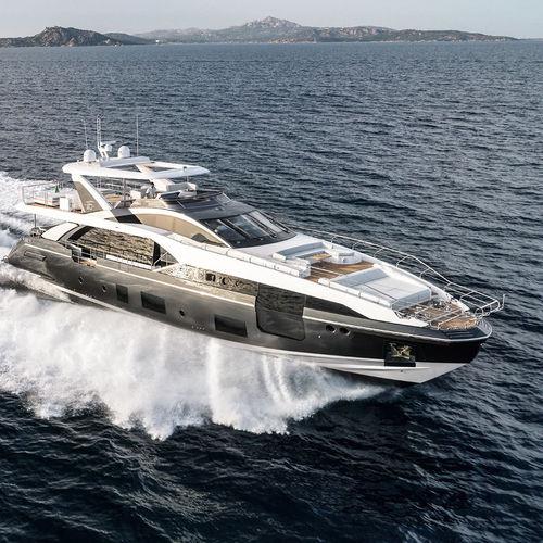 motor-yacht da crociera / con fly / in fibra di carbonio / GRP