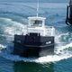barca professionale barca per il recupero di idrocarburi / entrobordo